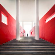 An external staircase lined with bright red walls