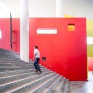 An external staircase in India lined with bright red walls