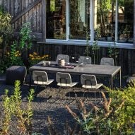 Outdoor dining space among plants in Italy
