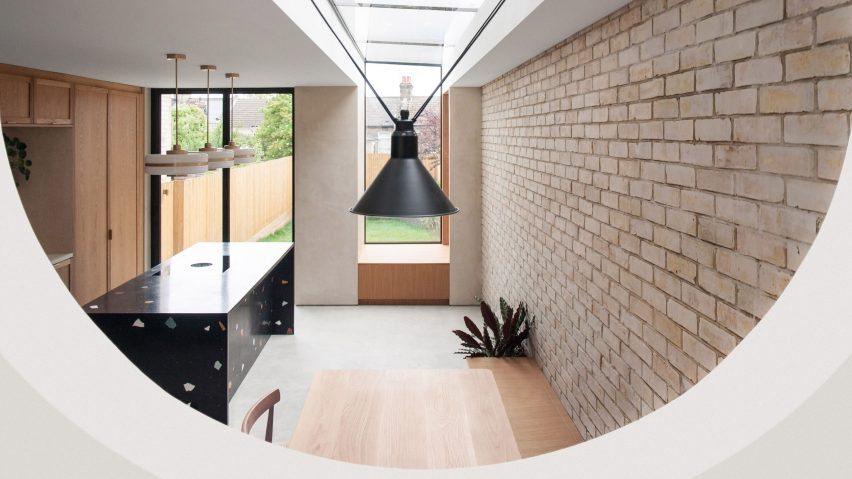 Kitchen with brick wall and terrazzo kitchen island