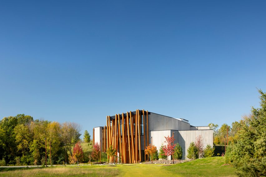 The new museum sits on a grassy and tree-dotted hillside