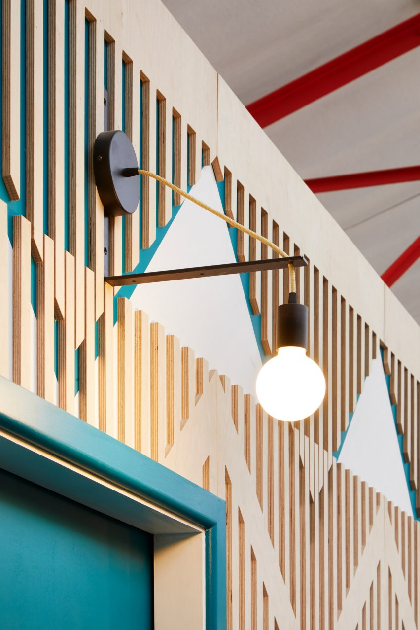 Colourful plywood walls inside a London music studio
