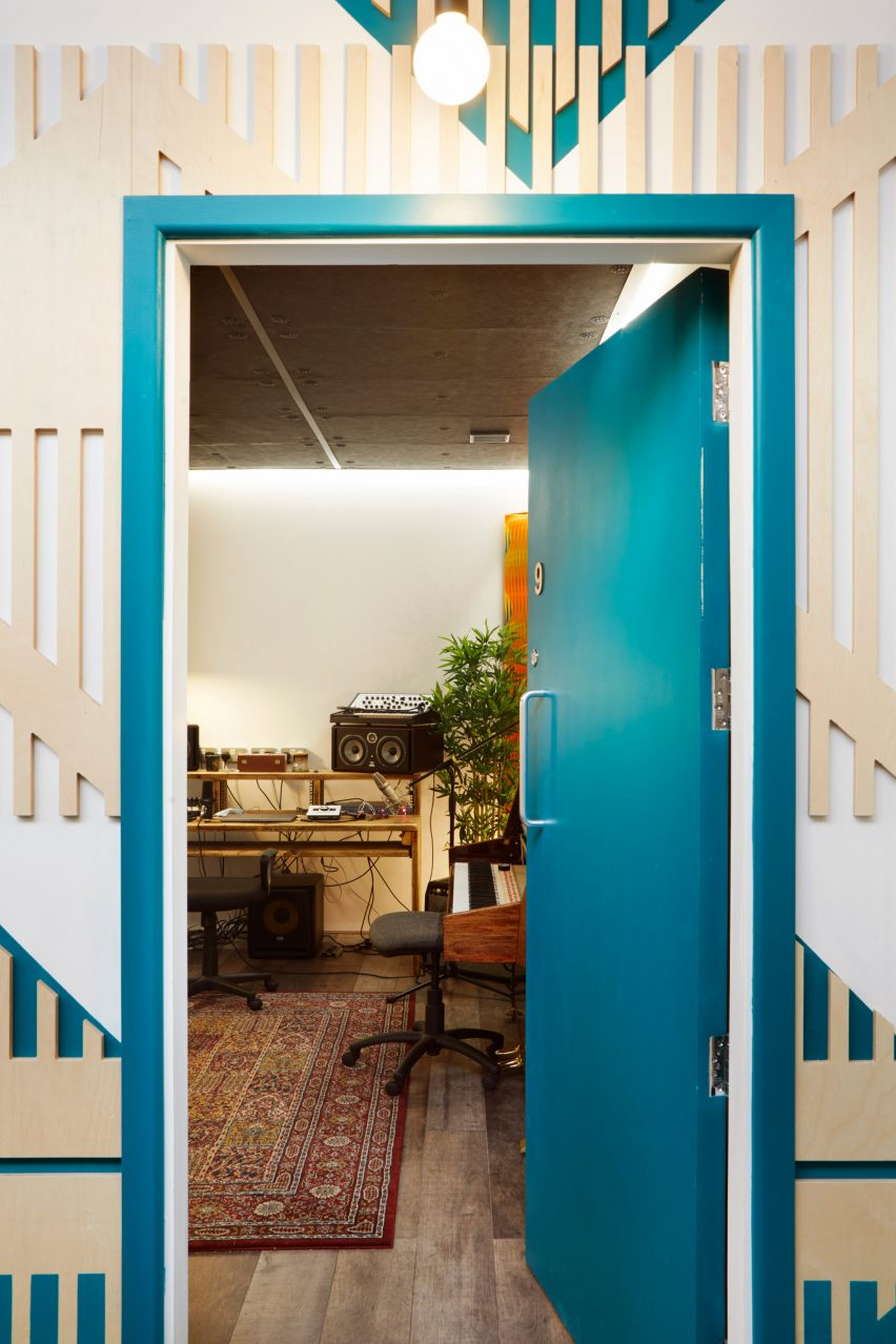 A teal-hued door leading into a London music studio