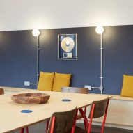 A navy-walled meeting room by Alma-nac