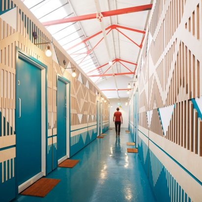 A colourful and patterned corridor made from plywood