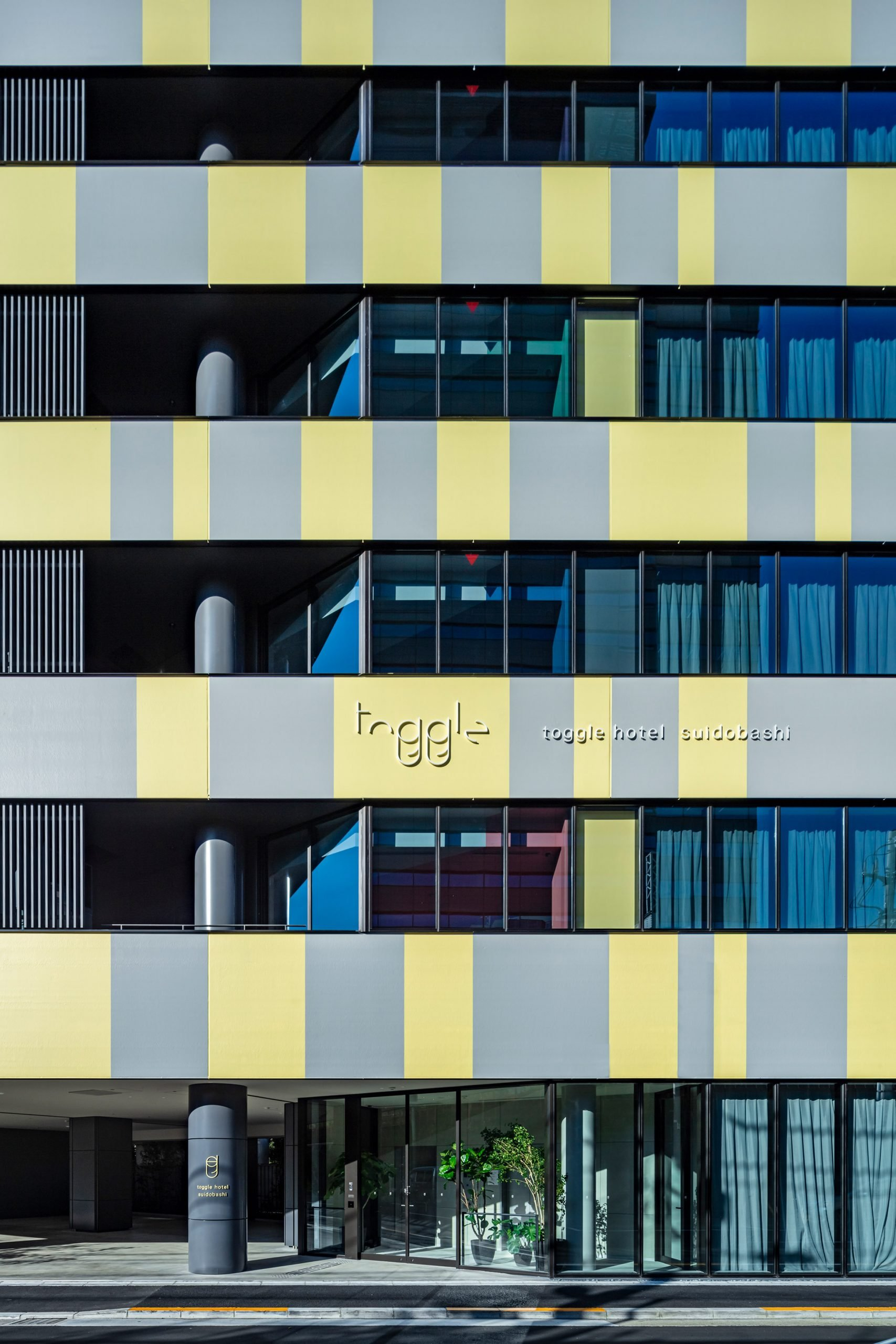 Toggle Hotel in Tokyo has grey and yellow facades