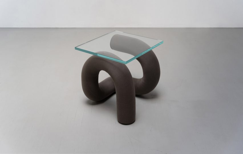 Ulu Table has a glass top