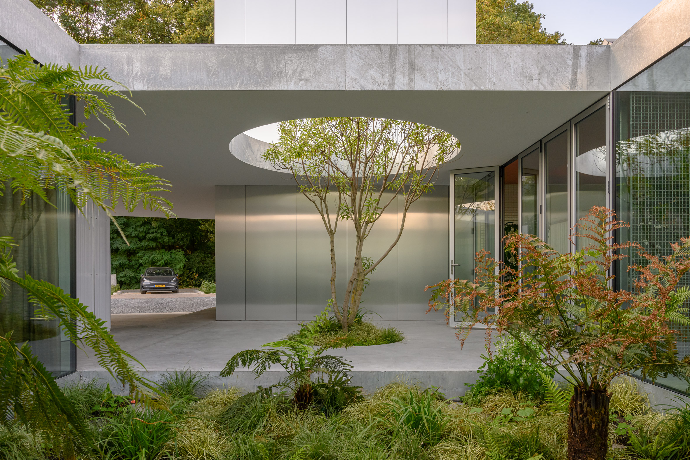 A courtyard lined with concrete and polished metal