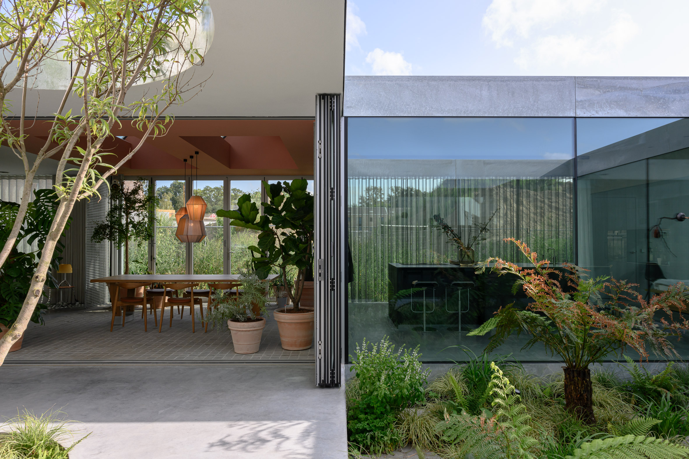 The glass elevation and courtyards of a Dutch family house