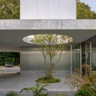 A courtyard lined with concrete and polished-metal
