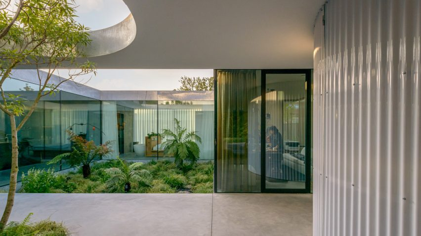 A sheltered courtyard within the industrial Villa Fifty-Fifty house
