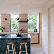 Wooden kitchen with marble kitchen island