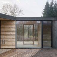 Steel-clad villa with wooden deck