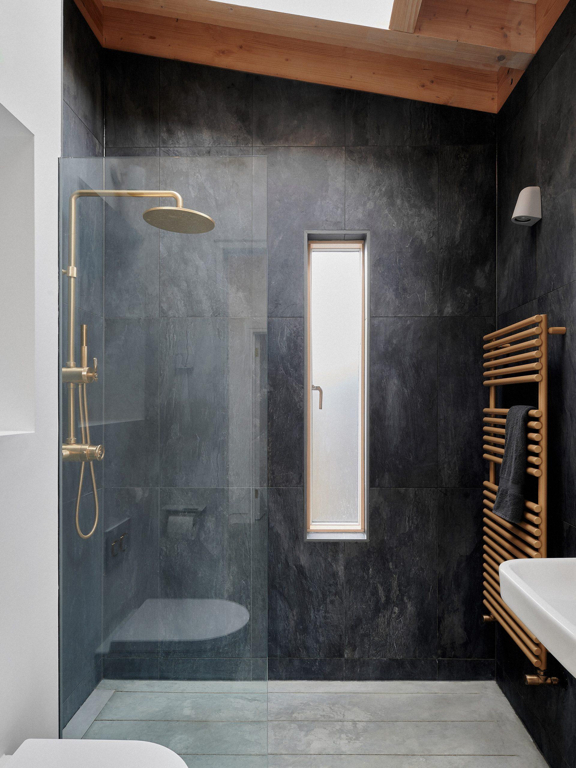A black-tiled shower room