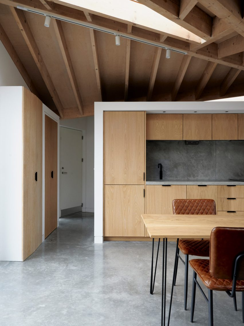 A kitchen with an exposed timber roof