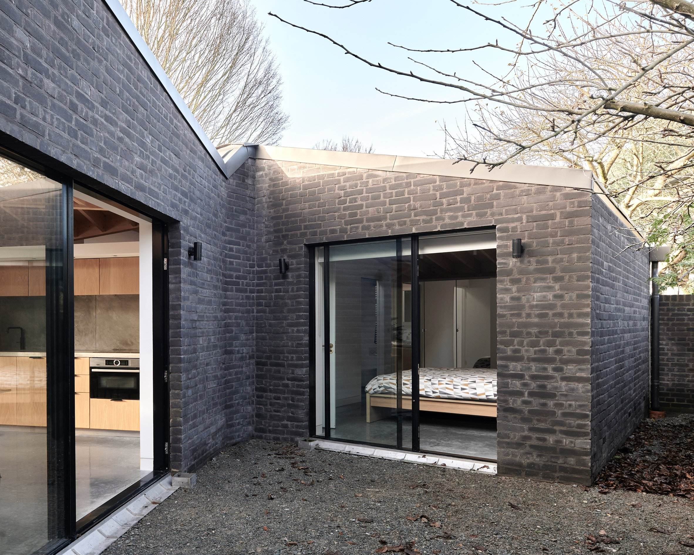 A London house clad in black brick