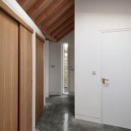 A hallway with an exposed timber roof