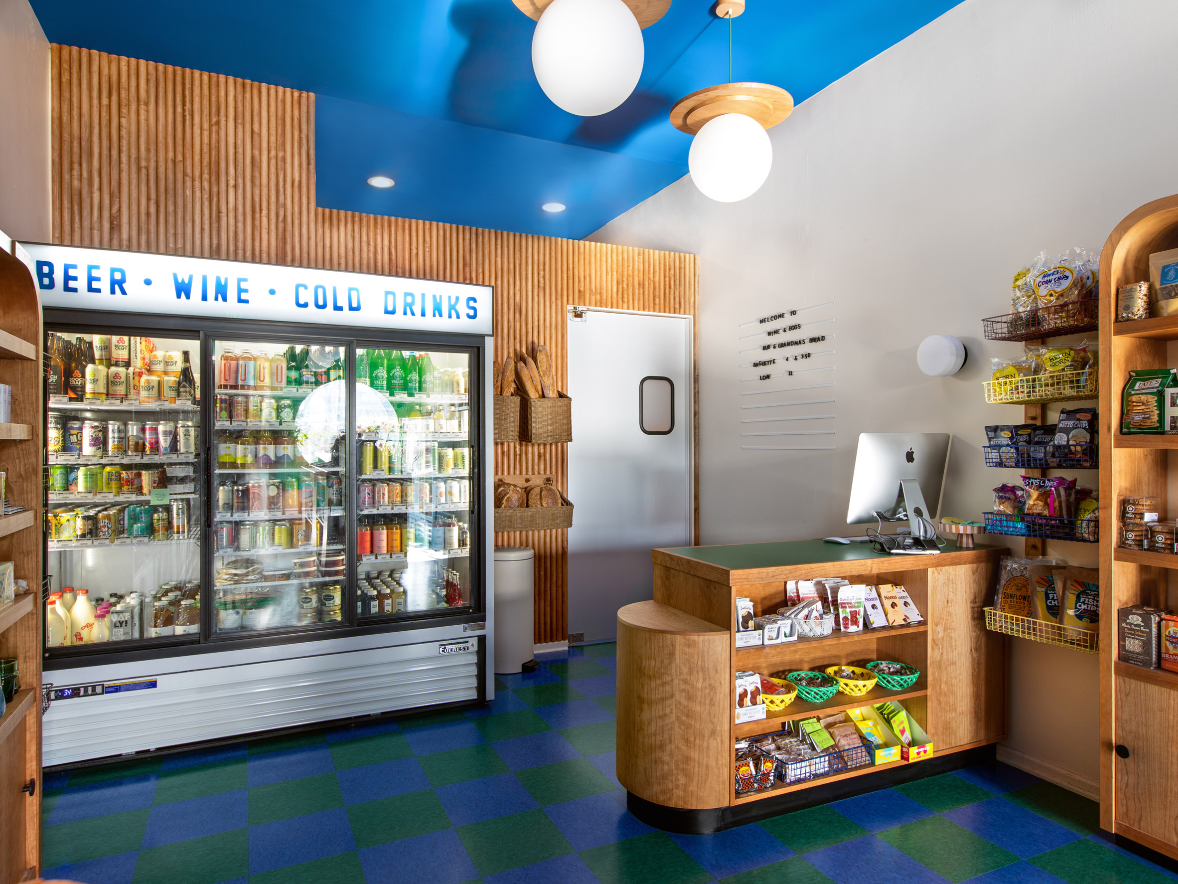 Wine and grocery store with blue and green floor