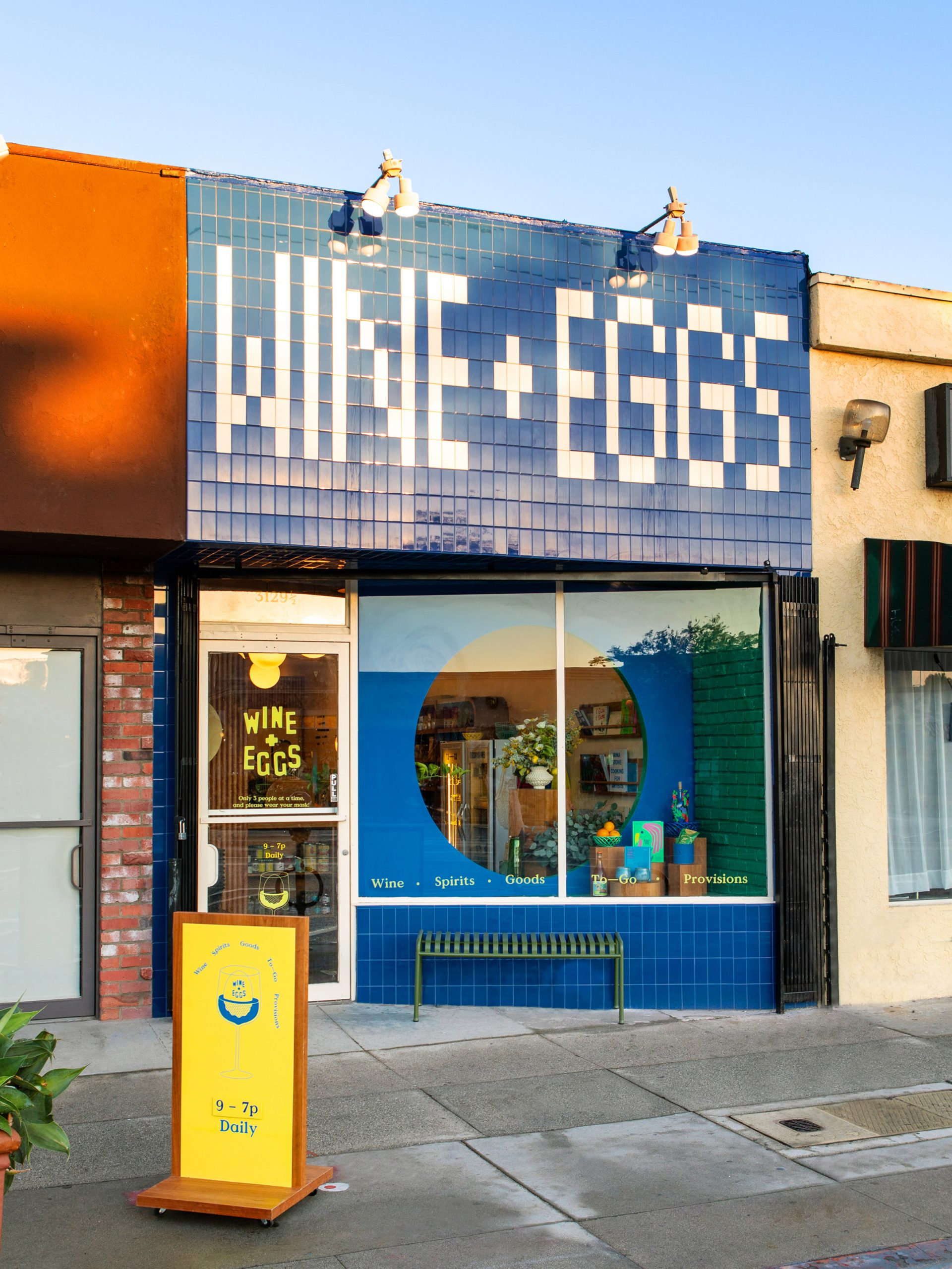 Blue and white tiled wine storefront