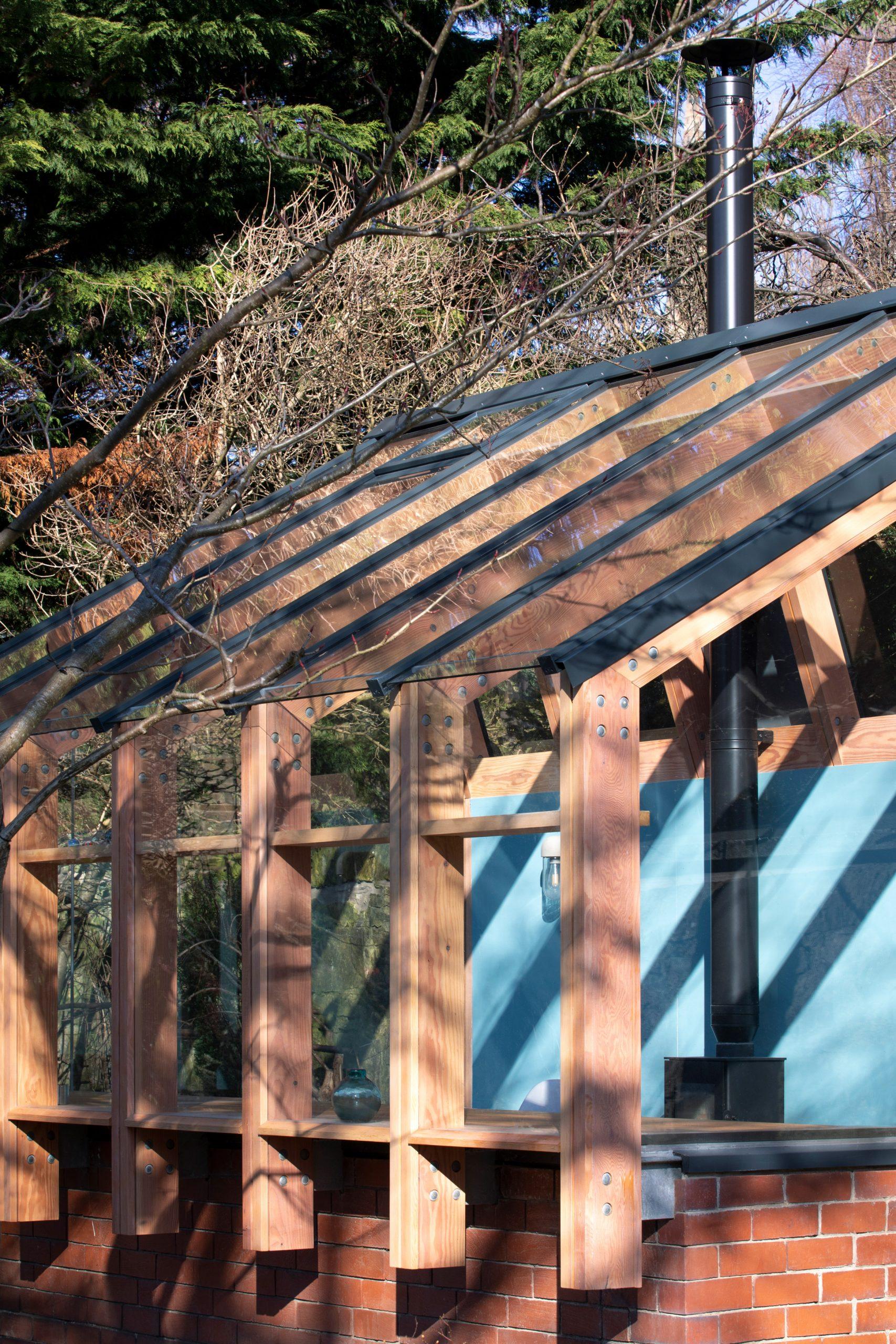 Timber frame of glass garden studio