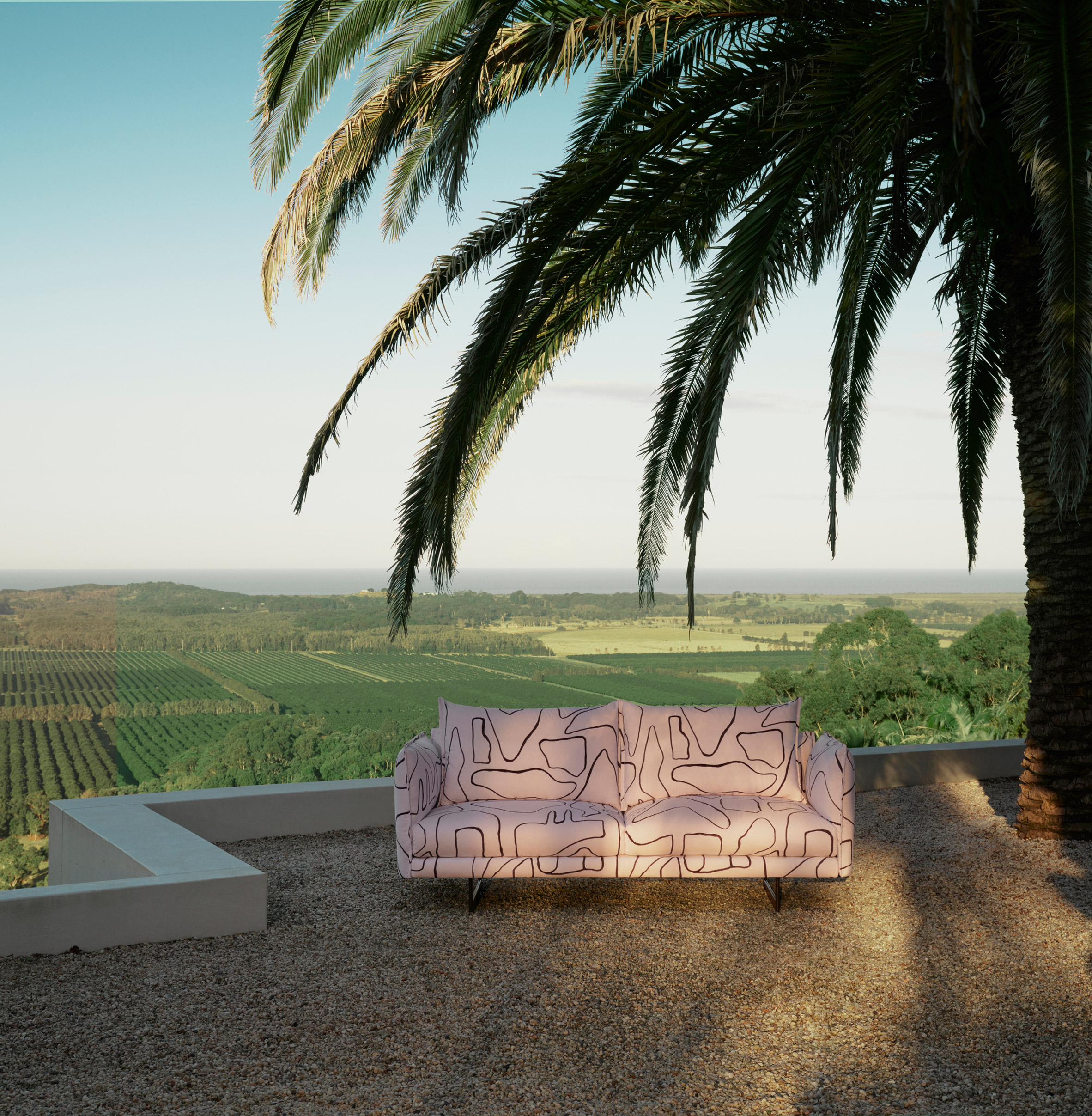 Zaza outdoor sofa by Charles Wilson for King Living on a terrace