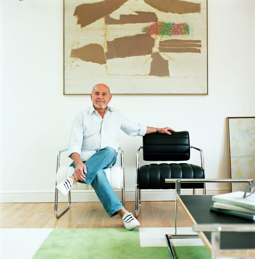 Zeev Aram photographed in his home