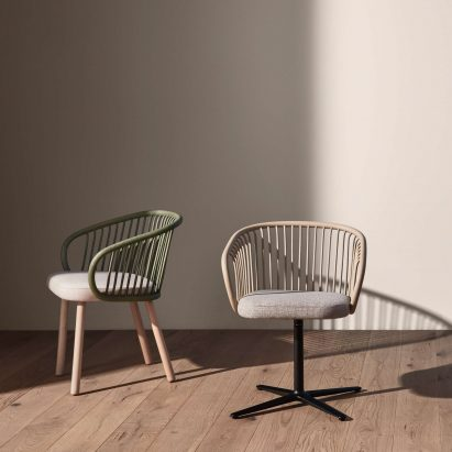 Huma armchair by Mario Ruiz for Expormim with a swivel base and beech wood legs as well as a rattan backrest