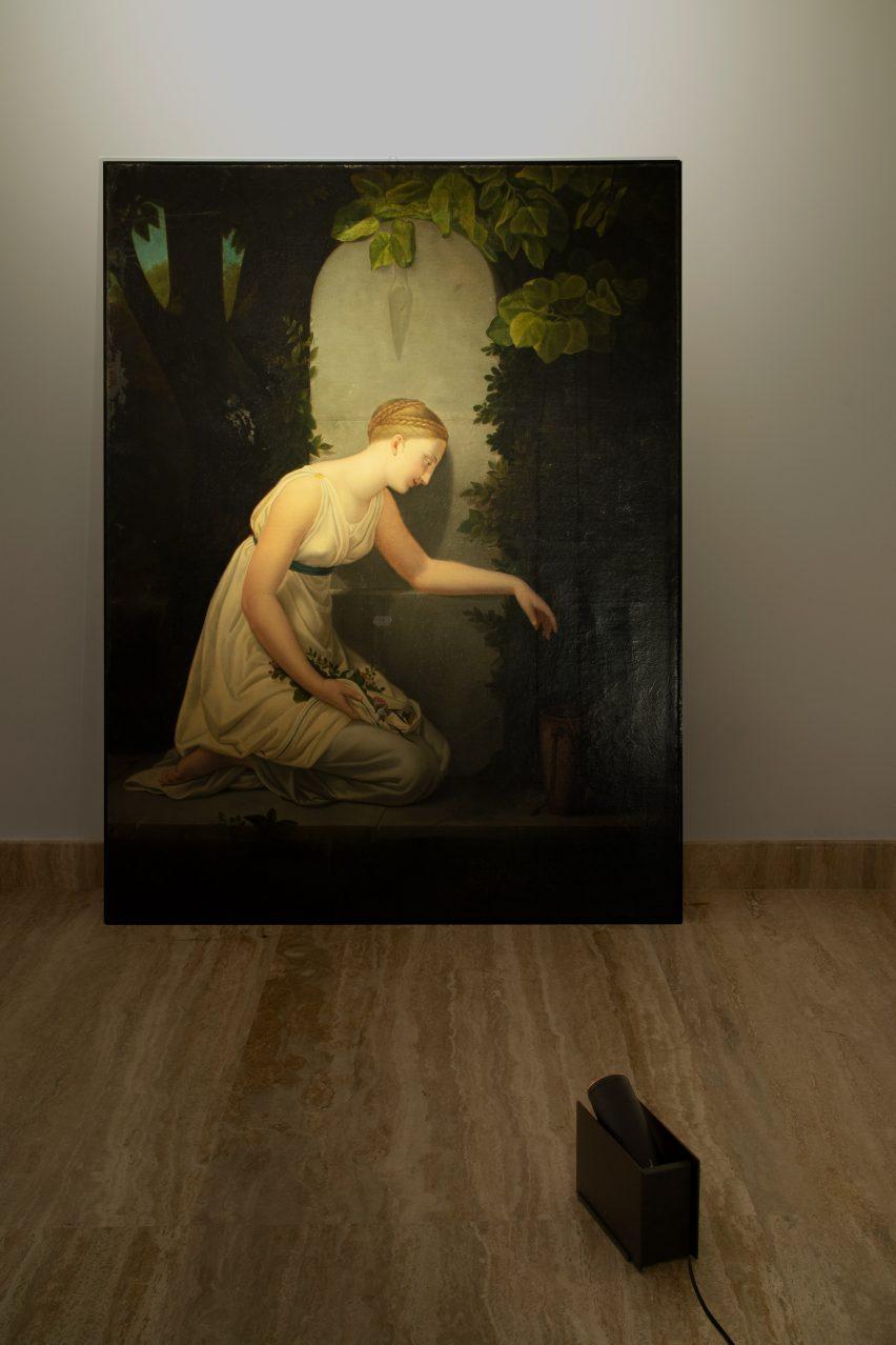 Plint light by Massimo Colagrande for Nemo Lighting illuminating a painting