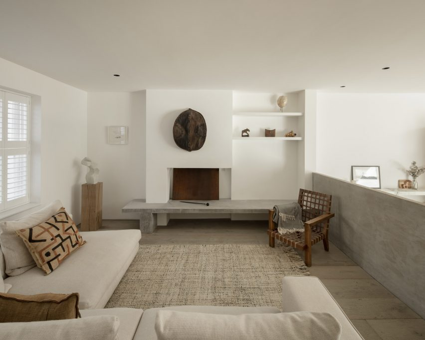 The pared-back living room of AC Residence
