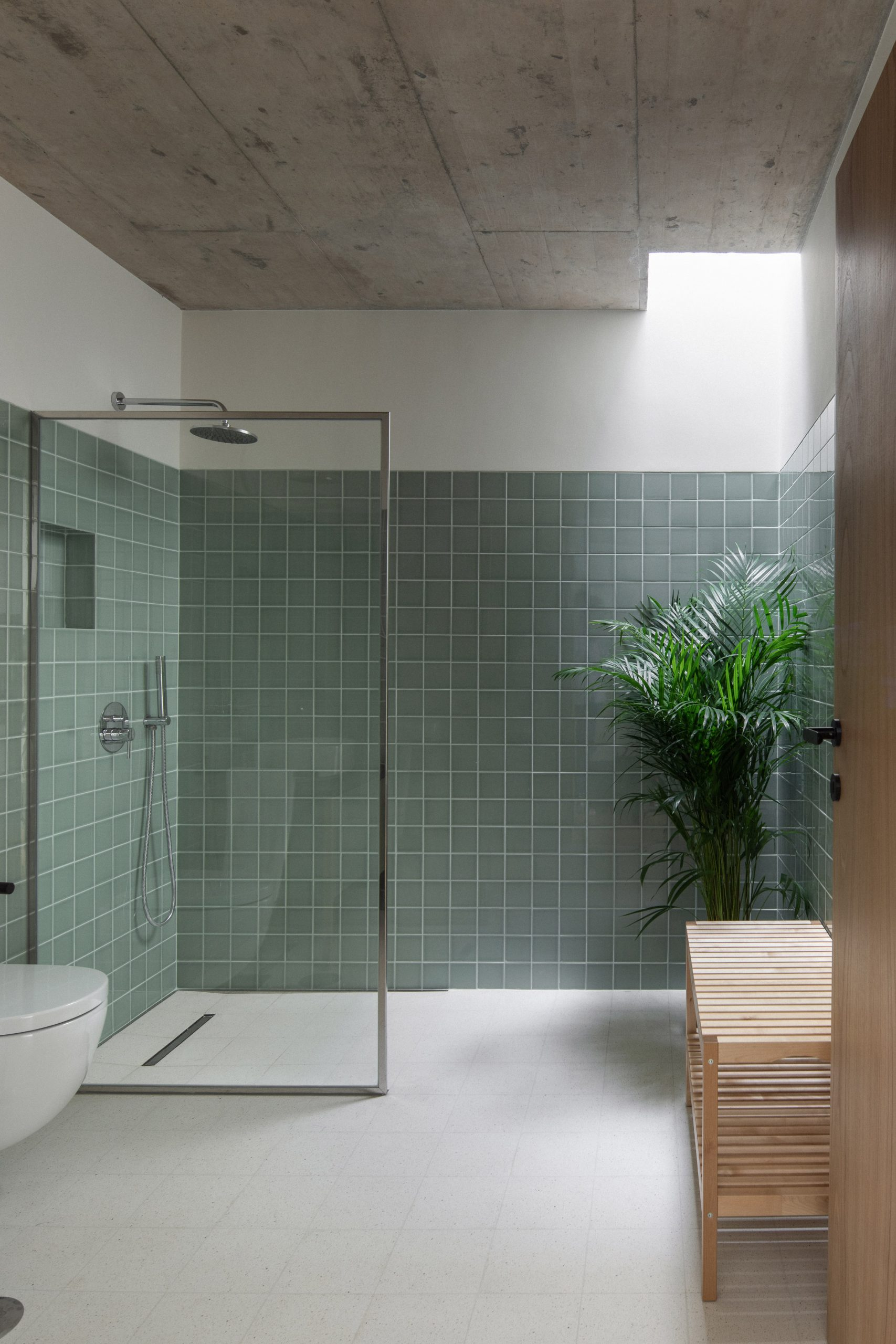 Its bathroom employs a sage tiled design