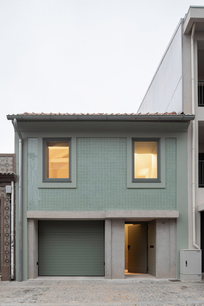 The facade has a concrete and tile material palette by depA Architects