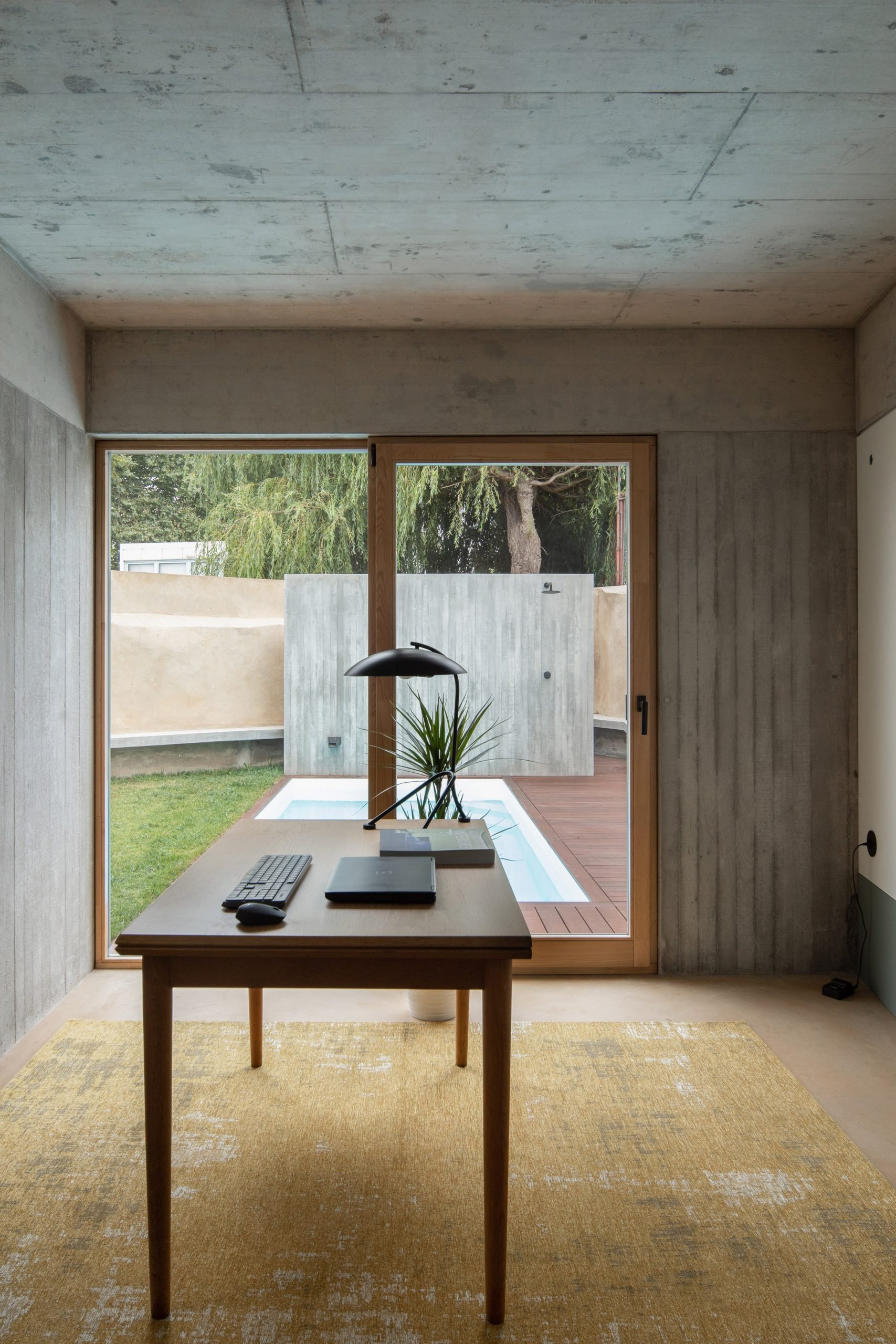 Concrete covers the ceilings and walls by depA Architects