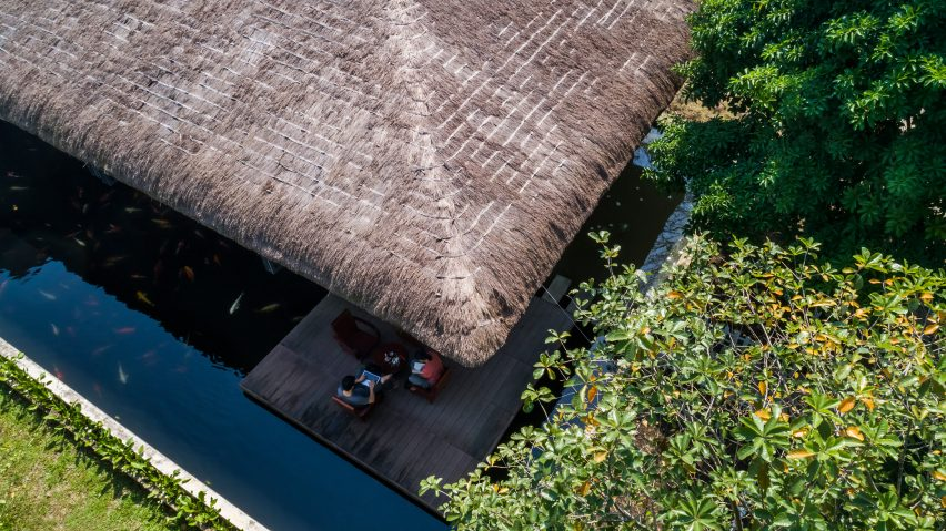 A holiday home with a thatched roof