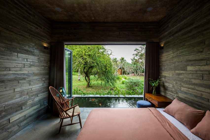 A concrete-walled bedroom