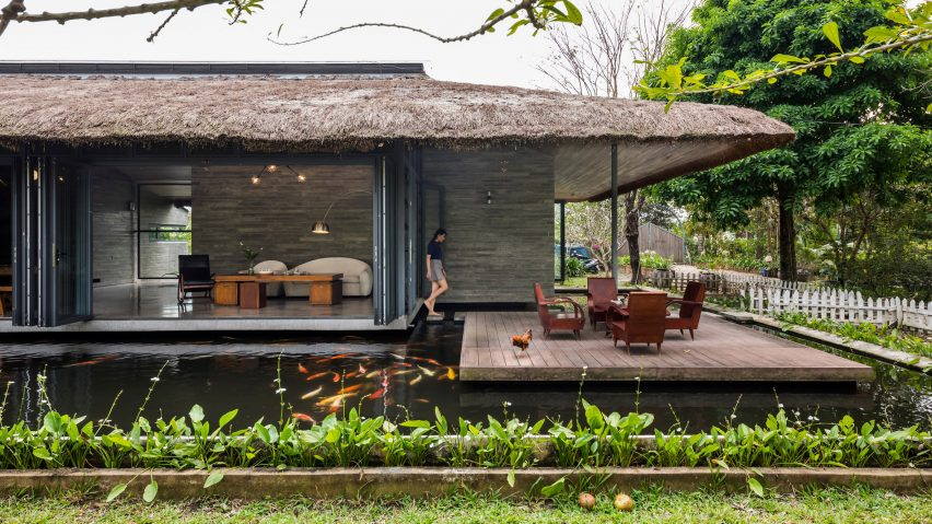 A Vietnamese holiday home with a thatched roof