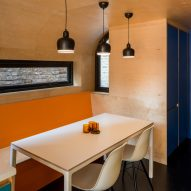 A wooden kitchen with pops of colour