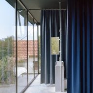 A bathroom with curtain partitions