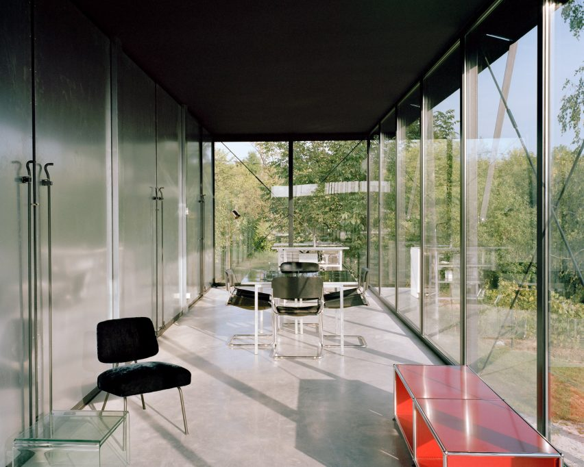 A living room with floor-to-ceiling glass windows