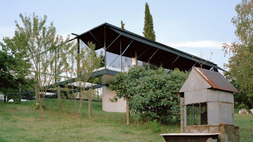 A steel-framed house on a mountainside