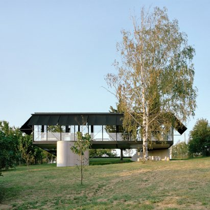 An elevated steel-framed house
