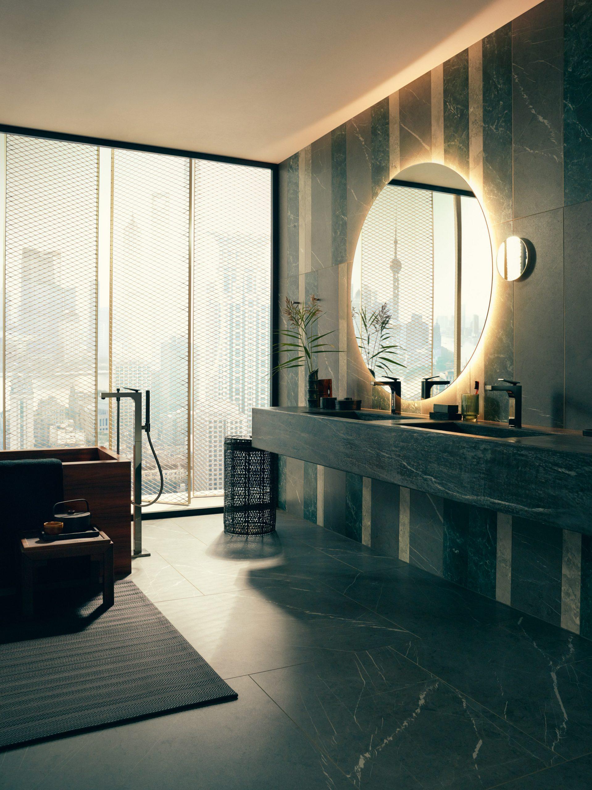 A dark stone-lined bathroom