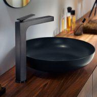 A black tap and circular sink
