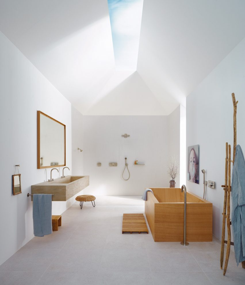 A white bathroom with wooden detailing