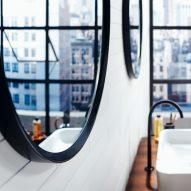 Circular mirrors in a white bathroom