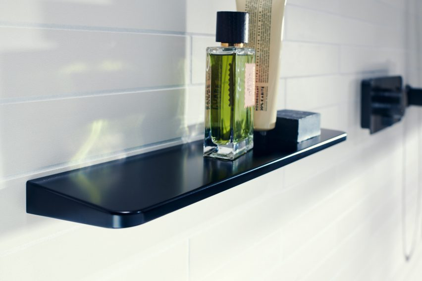 A black bathroom shelf