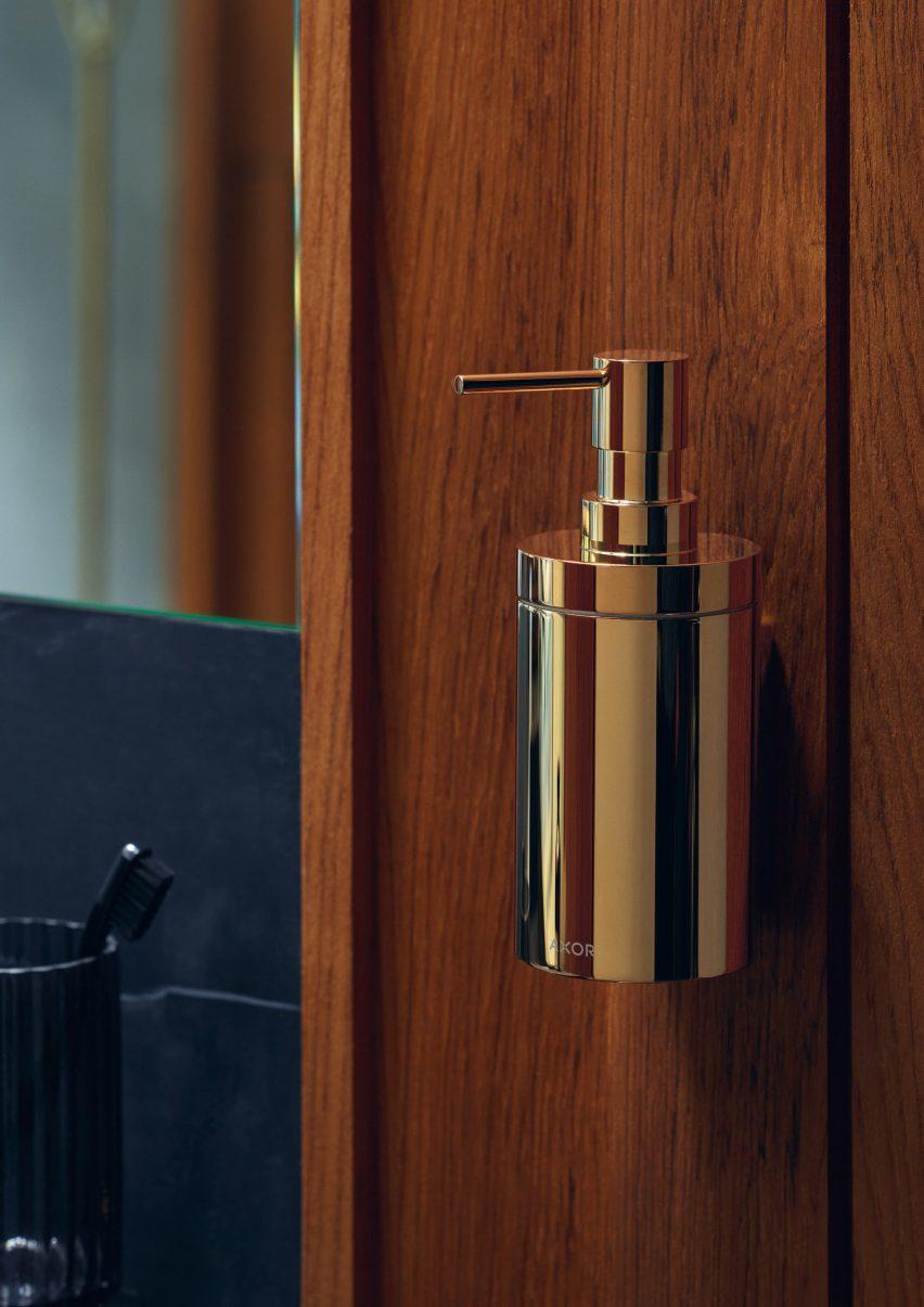 A gold-coloured soap dispenser