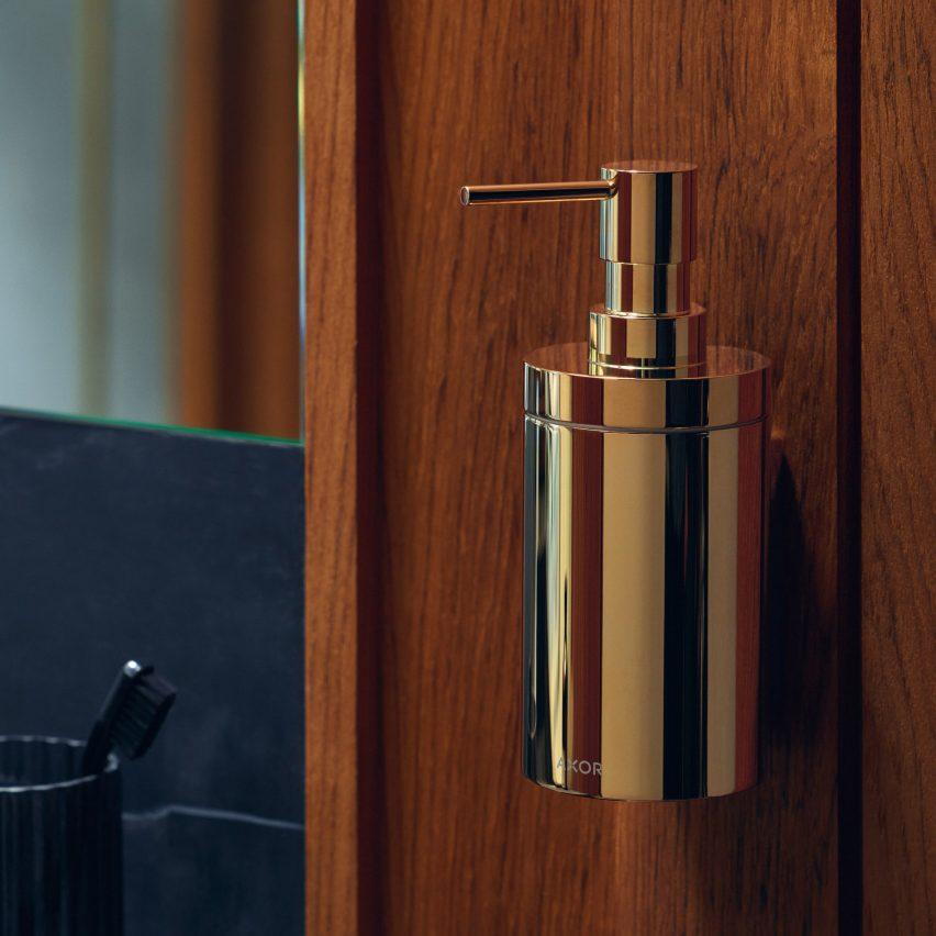 A brass soap dispenser by Axor
