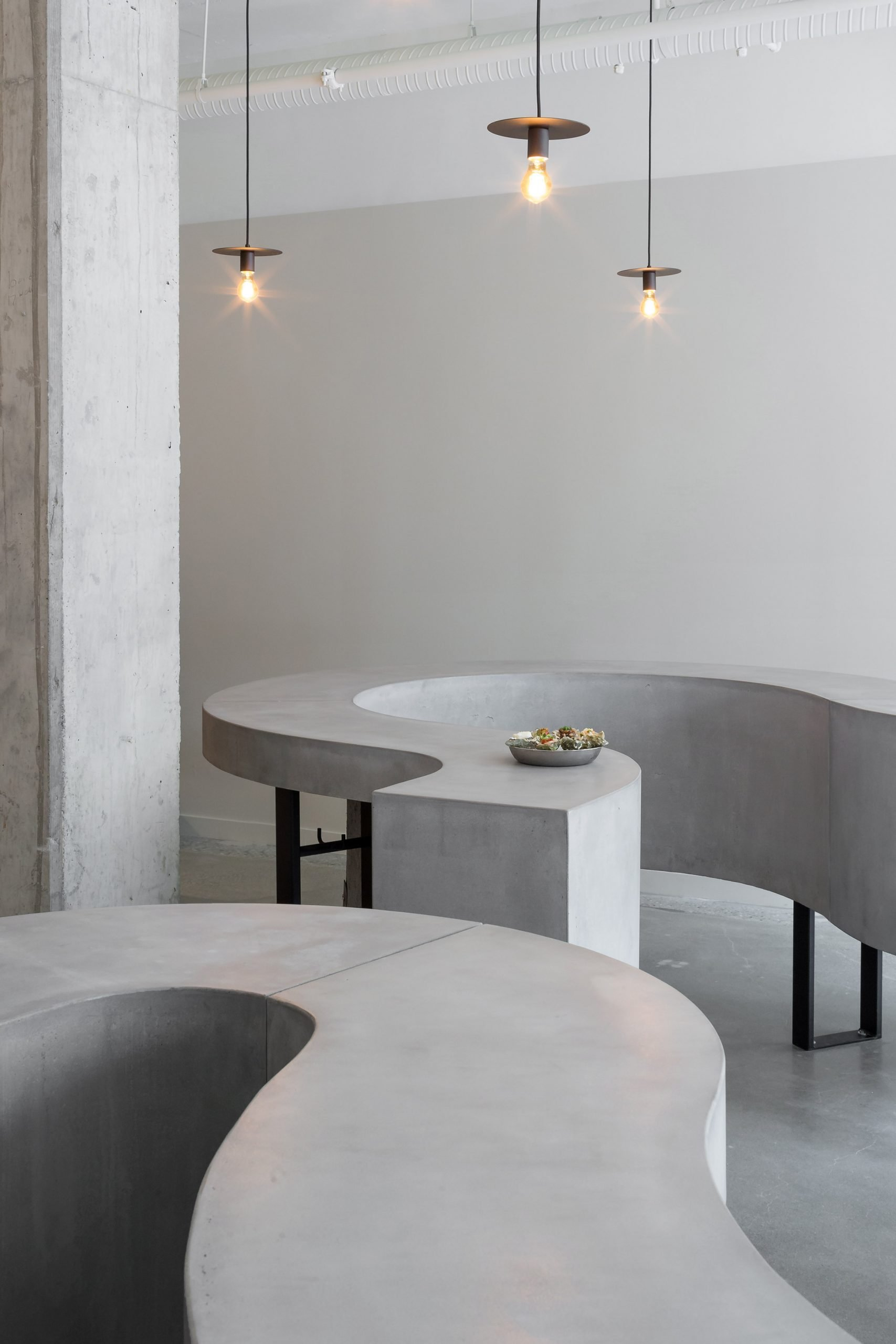 Pendant lamps and concrete tables in ShuckShuck