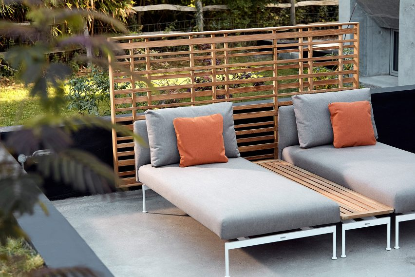 Layout lounge chairs on a patio by Barlow Tyrie