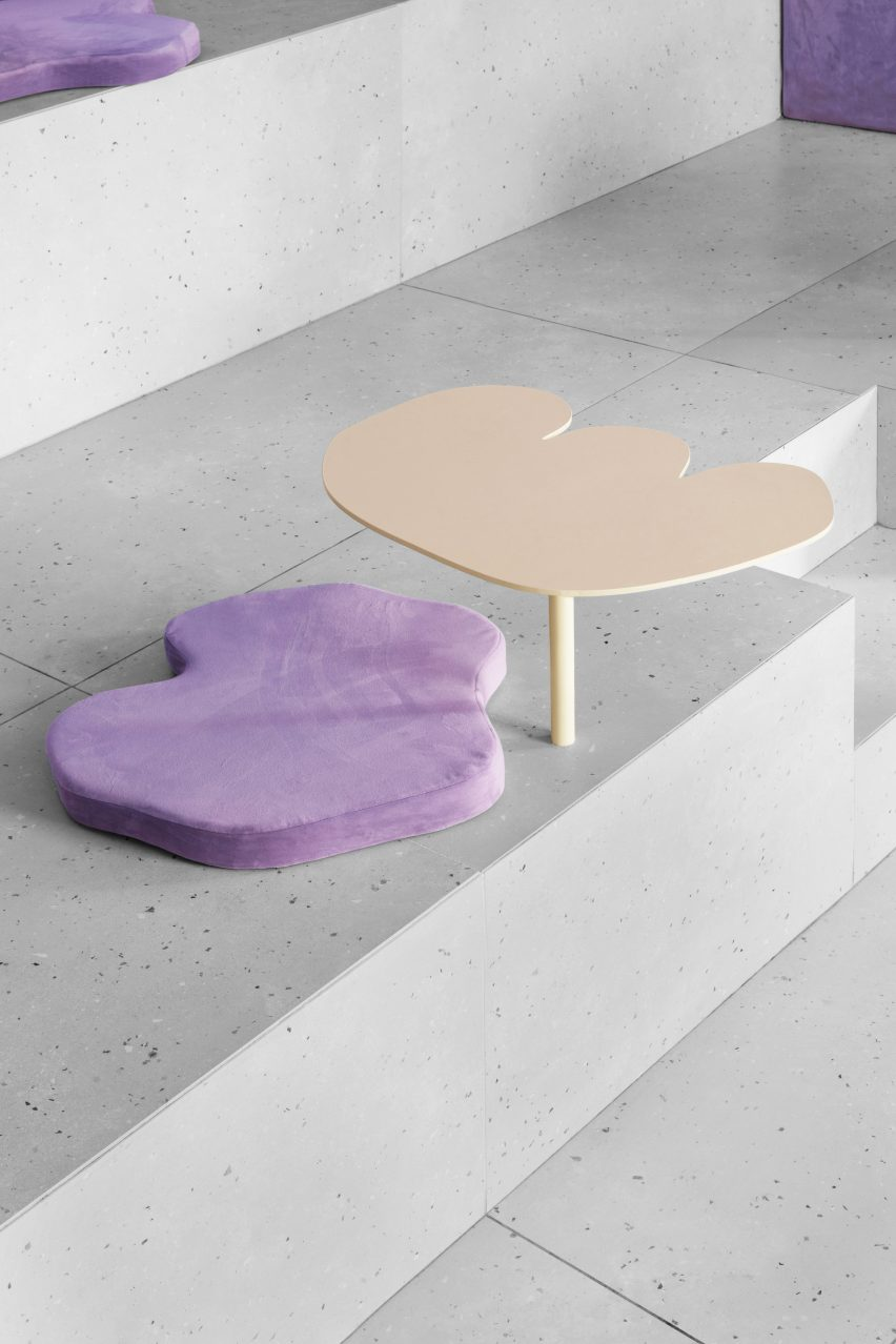 Table and cushion against concrete seat